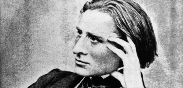 Franz Liszt leaning graciously on a piano
