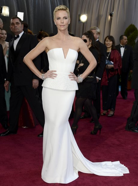 Charlize Theron attends the Oscars 2013 Red Carpet