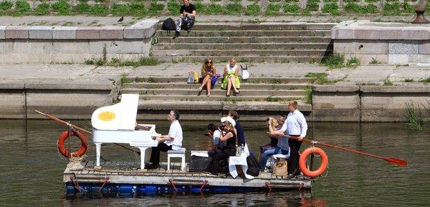 Petras Geniusas performs on a river