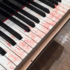 blood stained piano keyboard